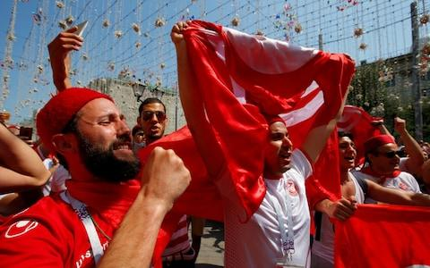 Tunisia fans ahead of their side's second World Cup match against Belgium - Credit: Sergei Karpukhin/Reuters