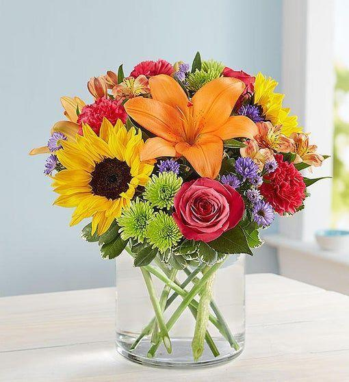 """<p>1800flowers.com</p><p><strong>$39.99</strong></p><p><a href=""""https://go.redirectingat.com?id=74968X1596630&url=https%3A%2F%2Fwww.1800flowers.com%2Fflorist-delivered-floral-embrace-167891&sref=https%3A%2F%2Fwww.menshealth.com%2Ftechnology-gear%2Fg32270252%2Fcheap-mothers-day-gifts%2F"""" rel=""""nofollow noopener"""" target=""""_blank"""" data-ylk=""""slk:BUY IT HERE"""" class=""""link rapid-noclick-resp"""">BUY IT HERE</a></p><p>Celebrate your mom on her special day with a bouquet of spring flowers, bursting with color. Bonus: 1-800-Flowers bouquets usually last longer than a week.</p>"""