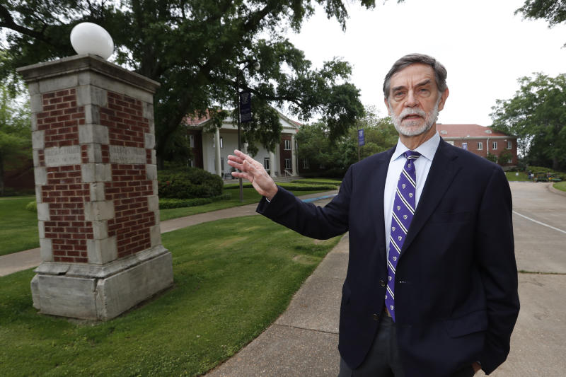 Millsaps College president Robert W. Pearigen speaks about the history of some of the buildings at the small liberal arts college in Jackson, Miss., Friday, April 3, 2020. With students online learning in face of the coronavirus, Pearigen and other small college leaders face an unusual set of financial and enrollment challenges because of the virus. (AP Photo/Rogelio V. Solis)