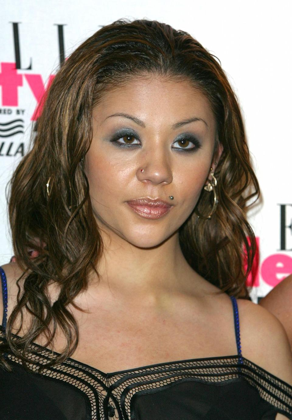 <p>Then: Mutya was easily one of the most quirkiest members of the Sugababes with several piercings and a kooky dress sense. [Photo: Getty] </p>