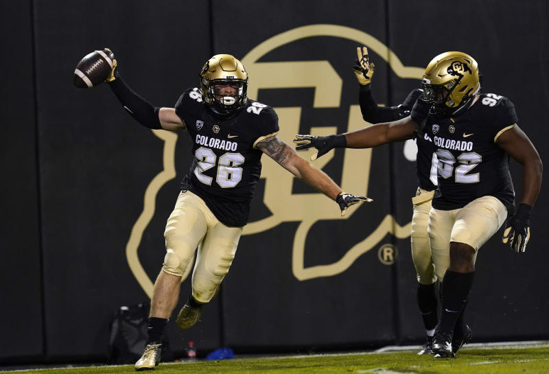 Colorado linebacker Carson Wells, left, celebrates his interception of a pass with defensive tackle Lloyd Murray Jr. in the first half of an NCAA college football game against UCLA, Saturday, Nov. 7, 2020, in Boulder, Colo. (AP Photo/David Zalubowski)