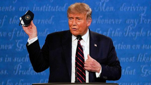 PHOTO:President Donald Trump holds up his face mask during the first presidential debate at Case Western University and Cleveland Clinic, in Cleveland, Sept. 29, 2020. (Julio Cortez/AP)