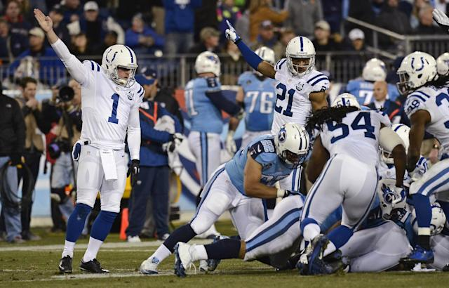 Indianapolis Colts kicker Pat McAfee (1) and teammate Jalil Brown (21) signal that the Colts have recovered the ball after Tennessee Titans' Devon Wylie fumbled a kickoff in the third quarter of an NFL football game Thursday, Nov. 14, 2013, in Nashville, Tenn. (AP Photo/Mark Zaleski)