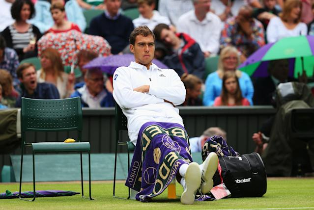 LONDON, ENGLAND - JUNE 28: Jerzy Janowicz of Poland waits for the centre court roof to close prior to the Gentlemen's Doubles third round match against Nicolas Almagro of Spain on day five of the Wimbledon Lawn Tennis Championships at the All England Lawn Tennis and Croquet Club on June 28, 2013 in London, England. (Photo by Julian Finney/Getty Images)