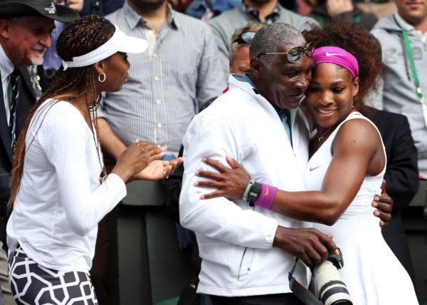 Serena Williams (R) of the USA celebrates with her father Richard Williams and sister Venus Williams after her Ladies' Singles final match against Agnieszka Radwanska of Poland on day twelve of the Wimbledon Lawn Tennis Championships at the All England Lawn Tennis and Croquet Club on July 7, 2012 in London, England. (Photo by Julian Finney/Getty Images)