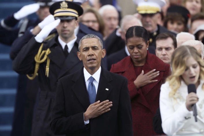 <p>Former president Barack Obama and former First Lady Michelle Obama listen during the national anthem during inauguration ceremonies swearing in Donald Trump as the 45th president of the United States on the West front of the U.S. Capitol in Washington on Jan. 20, 2017. (Photo: Carlos Barria/Reuters) </p>