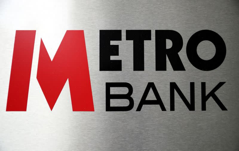 Signage is seen outside of a Metro Bank in London