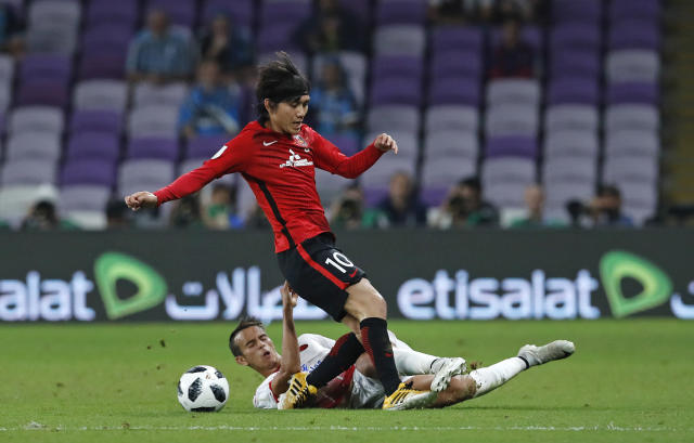 Japan's Urawa Reds Yosuke Kashiwagi is challenged by Morocco's Wydad Athletic Club Badr Gaddarine during the Club World Cup soccer match for the fifth place between Wydad Athletic Club and Urawa Reds at the Hazza Bin Zayed stadium in Al Ain, United Arab Emirates, Tuesday, Dec. 12, 2017. (AP Photo/Hassan Ammar)