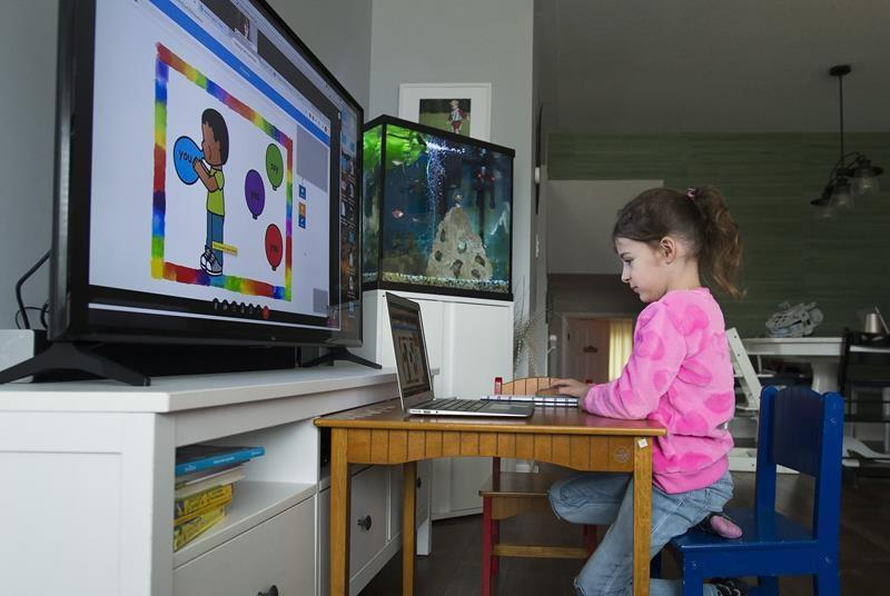 Parents, teachers say transition to e-learning will be a learning process