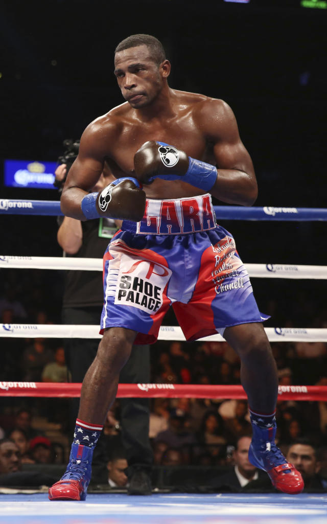 FILE - In this Oct. 14, 2017, file photo, Erislandy Lara in action against Terrell Gausha during the Super WBA/IBO Super Welterweight World Championship match, Saturday, Oct. 14, 2017, in New York. Lara and fellow boxing star Luis Ortiz left behind their lives in Cuba for the ones they wanted for themselves and their families in the United States. (AP Photo/Steve Luciano, File)