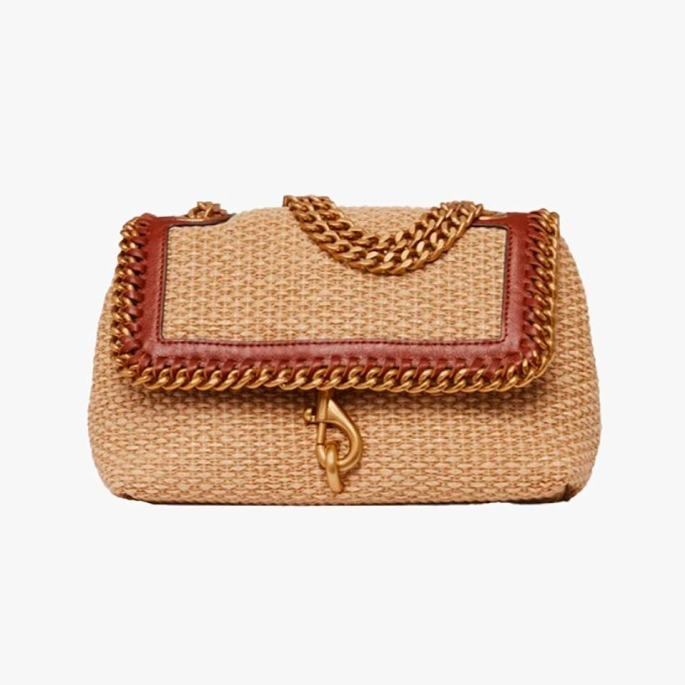 """$198, REBECCA MINKOFF. <a href=""""https://www.rebeccaminkoff.com/products/edie-crossbody-with-woven-chain-hu21tstx20-nat-straw?variant=39288011489374"""" rel=""""nofollow noopener"""" target=""""_blank"""" data-ylk=""""slk:Get it now!"""" class=""""link rapid-noclick-resp"""">Get it now!</a>"""