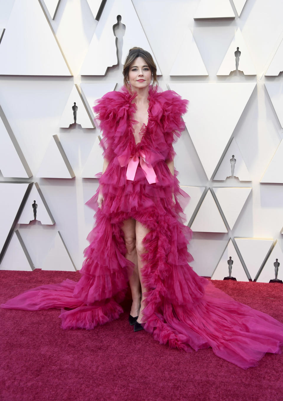 """<p>The """"Green Book"""" star vamped it up on the red carpet in a bright pink gown that is anything but subtle. (Image via Getty Images) </p>"""