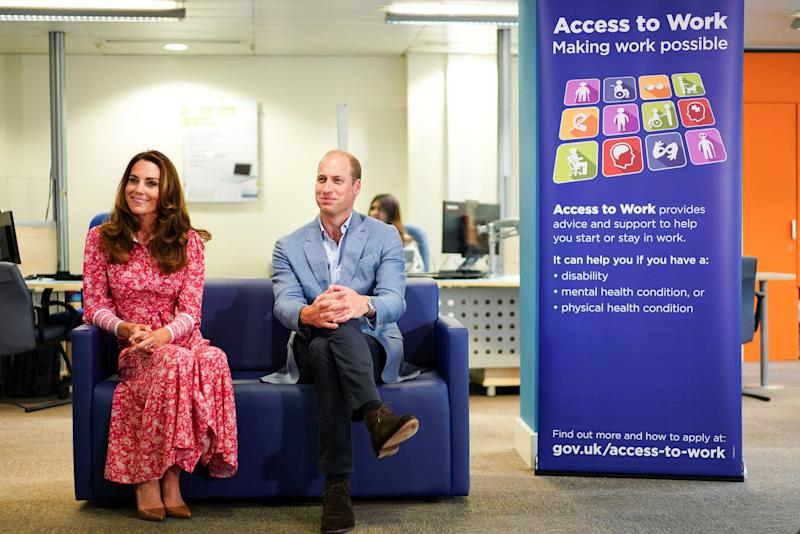 Britain's Prince William, Duke of Cambridge (R), and Britain's Catherine, Duchess of Cambridge (L) speak with people at the London Bridge Jobcentre, in London on September 15, 2020. - The Duke and Duchess of Cambridge carried out engagements in London today to meet local communities, hear about the challenges they have faced over the last six months, and shine a light on individuals and businesses who have gone above and beyond to help others during this extraordinary time. (Photo by HENRY NICHOLLS / POOL / AFP) (Photo by HENRY NICHOLLS/POOL/AFP via Getty Images)