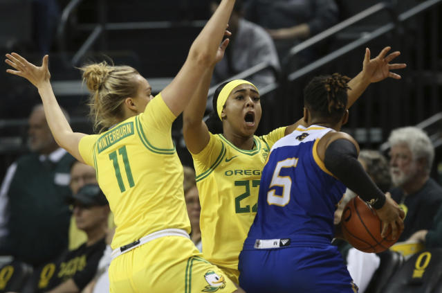 Oregon's Holly Winterburn, left, and Minyon Moore pressure UC Riverside's Lauryn Pointer during the second quarter of an NCAA college basketball game in Eugene, Ore., Monday, Dec. 16, 2019. (AP Photo/Chris Pietsch)