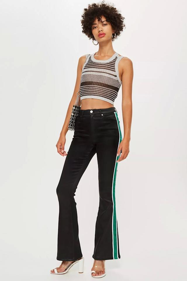 """<p>Add a pop of color to your look with these <a href=""""https://www.popsugar.com/buy/Topshop-Black-Satin-Jamie-Flare-Jeans-483427?p_name=Topshop%20Black%20Satin%20Jamie%20Flare%20Jeans&retailer=us.topshop.com&pid=483427&price=45&evar1=fab%3Aus&evar9=46531520&evar98=https%3A%2F%2Fwww.popsugar.com%2Fphoto-gallery%2F46531520%2Fimage%2F46531686%2FTopshop-Black-Satin-Jamie-Flare-Jeans&list1=shopping%2Cdenim%2Cjeans%2Csale%2Cpants%2Csale%20shopping&prop13=api&pdata=1"""" rel=""""nofollow"""" data-shoppable-link=""""1"""" target=""""_blank"""" class=""""ga-track"""" data-ga-category=""""Related"""" data-ga-label=""""https://us.topshop.com/en/tsus/product/sale-6923951/shop-all-sale-7108379/black-satin-jamie-flare-jeans-7913775"""" data-ga-action=""""In-Line Links"""">Topshop Black Satin Jamie Flare Jeans</a> ($45, originally $90).</p>"""