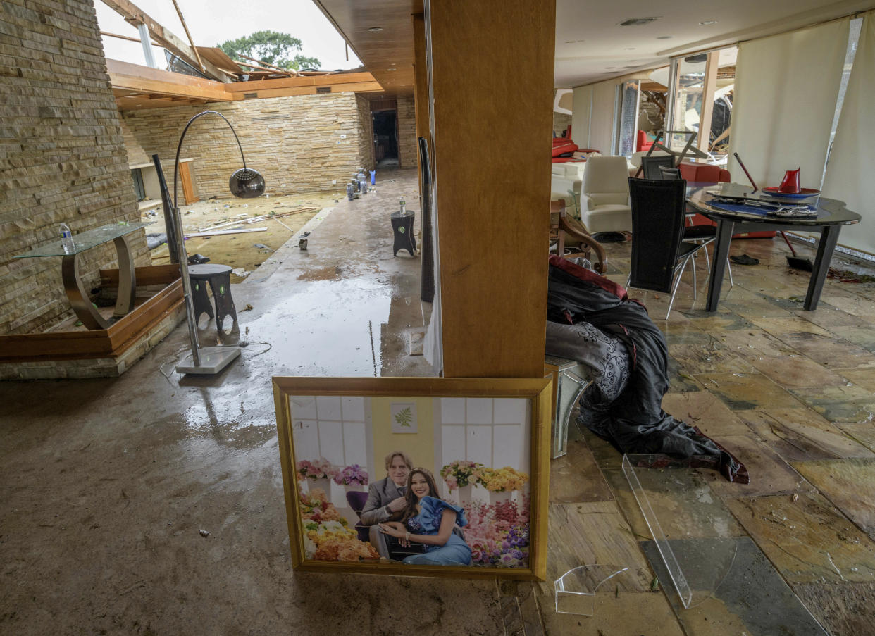 This photo shows the damaged home of Eric and Indra Ehlenberger in New Orleans on Wednesday, July 10, 2019, following a storm that swamped the city and paralyzed traffic. (Photo: Matthew Hinton/AP)