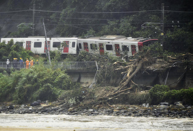 <p>A train remains derailed by a landslide caused by heave rains in Karatsu, Saga prefecture, southwestern Japan, Saturday, July 7, 2018. (Photo: Tsuyoshi Ueda/Kyodo News via AP) </p>