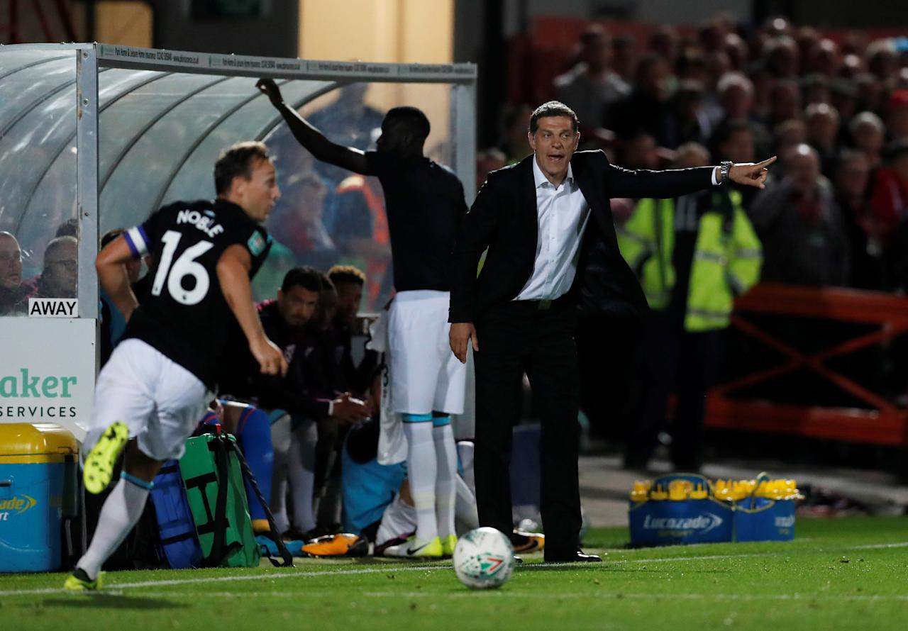 "Football Soccer - Carabao Cup - Second Round - Cheltenham Town vs West Ham United - Cheltenham, Britain - August 23, 2017   West Ham United manager Slaven Bilic gestures as Mark Noble is in action   Action Images via Reuters/Matthew Childs     EDITORIAL USE ONLY. No use with unauthorized audio, video, data, fixture lists, club/league logos or ""live"" services. Online in-match use limited to 45 images, no video emulation. No use in betting, games or single club/league/player publications. Please contact your account representative for further details."