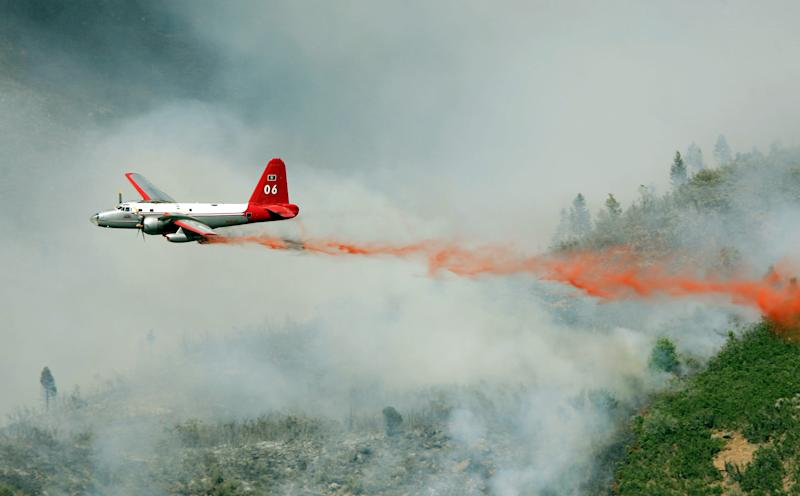 FILE - In this July 3, 2012 photo. an aircraft makes a drop on the Quail Fire above Alpine, Utah. The demise of a California company that built a device that sprays fire retardant from U.S. military C-130 cargo planes has some experts worried that a lack of spare parts and maintenance could create more problems for a program with a long record of success in fighting wildfires. Aero Union of Sacramento closed last year after the U.S. Forest Service canceled a contract worth a guaranteed minimum $14.5 million a year for six civilian air tankers, saying the company wasn't keeping up with inspections. (AP Photo/The Salt Lake Tribune, Steve Griffin)