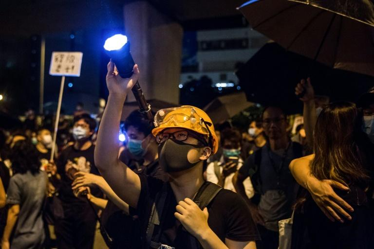 Protesters gather outside Kwai Chung police station in support of protesters detained with the charge of rioting during recent clashes in Hong Kong