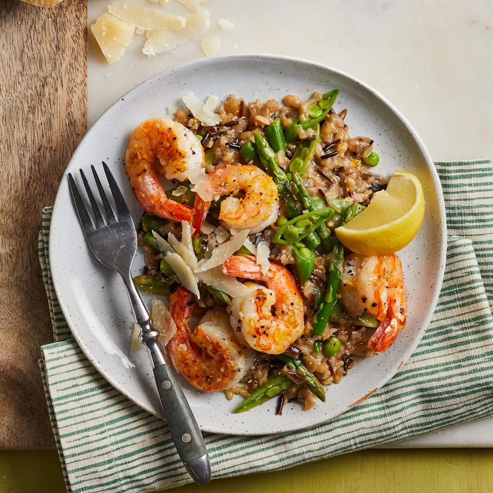 """<p>Asparagus, snap peas and a touch of lemon zest bring fresh spring flavor to this riff on classic risotto made with a whole-grain rice blend. <a href=""""https://www.eatingwell.com/recipe/7886351/wild-rice-risotto-with-shrimp-spring-vegetables/"""" rel=""""nofollow noopener"""" target=""""_blank"""" data-ylk=""""slk:View recipe"""" class=""""link rapid-noclick-resp""""> View recipe </a></p>"""