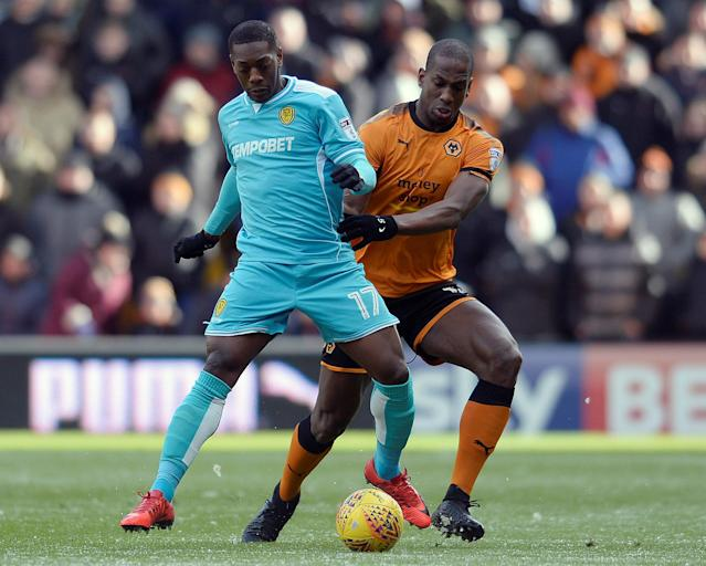 "Soccer Football - Championship - Wolverhampton Wanderers vs Burton Albion - Molineux Stadium, Wolverhampton, Britain - March 17, 2018 Burton's Marvin Sordell in action with Wolves' Willy Boly Action Images/Alan Walter EDITORIAL USE ONLY. No use with unauthorized audio, video, data, fixture lists, club/league logos or ""live"" services. Online in-match use limited to 75 images, no video emulation. No use in betting, games or single club/league/player publications. Please contact your account representative for further details."