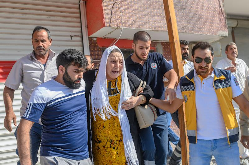 An elderly woman is evacuated from a building in Akcakale, a town near the Turkish border with Syria on October 13, 2019, after it was hit by a rocket reported to be fired from within Syria. - A total of 18 civilians and at least four Turkish soldiers have been killed since Turkey launched its offensive against Kurdish People's Protection Units (YPG) militia in Syria on October 9, 2019. (Photo by BULENT KILIC / AFP) (Photo by BULENT KILIC/AFP via Getty Images)