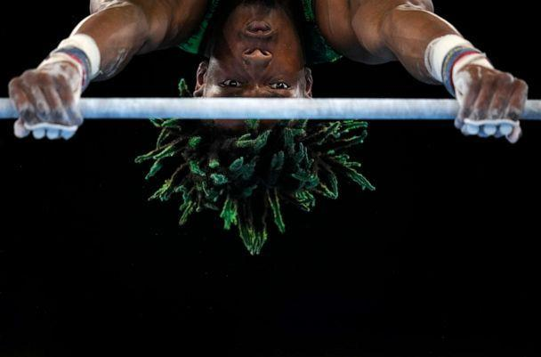 PHOTO: Uche Eke, of Nigeria, competes on the horizontal bar during the men's artistic gymnastic qualifications at the 2020 Summer Olympics, Saturday, July 24, 2021, in Tokyo, Japan. (Gregory Bull/AP Photo)