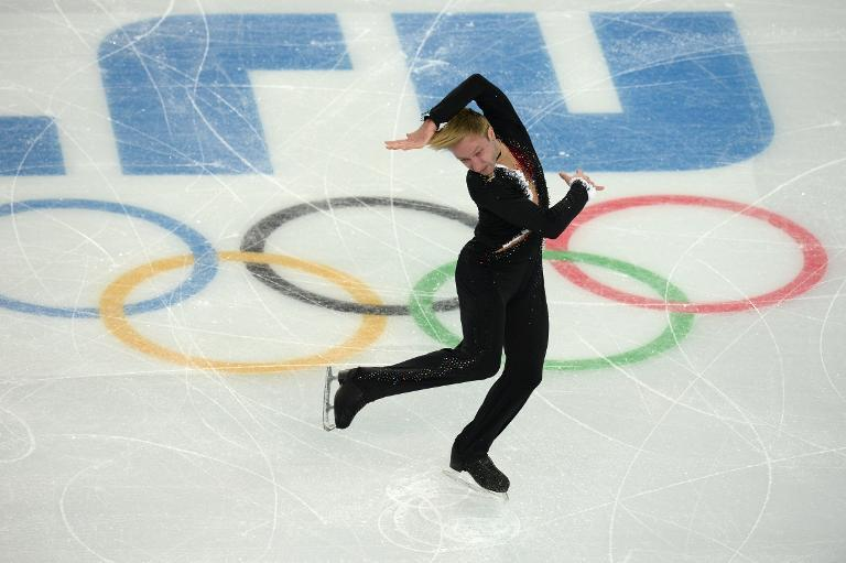 Russia's Yevgeny Plushenko performs in the Men's Figure Skating Team Short Program during the Sochi Winter Olympics on February 6, 2014