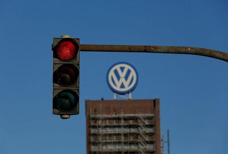 A traffic light shows red next to the Volkswagen factory in Wolfsburg