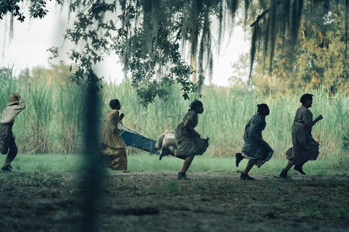Five enslaved persons running beneath willow branches