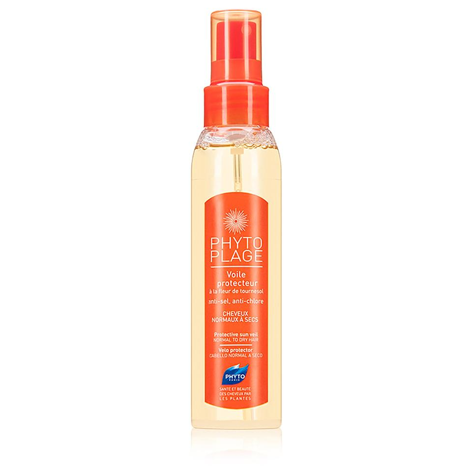"""<p>Phyto's Plage Protective Sun Veil uses sunflower extract (an antioxidant that also conditions) to protect hair. UV rays, chlorine, salt, and other hair nemeses do not stand a chance against this elixir, which will leave your crown silky, smooth, and shiny.</p> <p><strong>$30</strong> (<a href=""""https://shop-links.co/1639252186434264781"""" rel=""""nofollow noopener"""" target=""""_blank"""" data-ylk=""""slk:Shop Now"""" class=""""link rapid-noclick-resp"""">Shop Now</a>)</p>"""