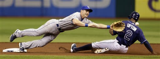 Kansas City Royals second baseman Johnny Giavotella dives for the ball as Tampa Bay Rays' B.J. Upton (2) steals second base during the first inning of a baseball game Wednesday, Aug. 22, 2012 in St. Petersburg, Fla. (AP Photo/Chris O'Meara)