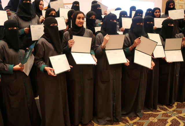 Saudi women hold their diplomas during the graduation ceremony of Saudi women car-accident inspectors, a few days before women are set to take the wheel in Riyadh, Saudi Arabia June 21, 2018. Picture taken June 21, 2018. REUTERS/Noemie Olive TPX IMAGES OF THE DAY