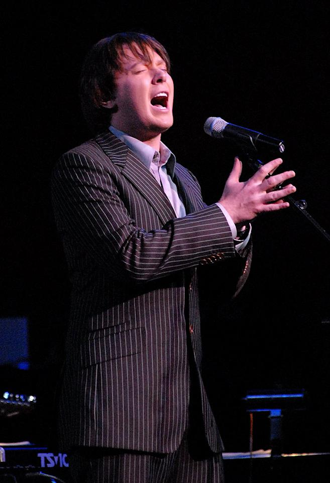 "<a href=""/clay-aiken/contributor/1207678"">Clay Aiken</a> is the reason why so many <a href=""/american-idol/show/34934"">""American Idol""</a> also-rans dream of the ""wild card"" policy being reinstated. The skinny pencil-necked kid with the unexpectedly mature voice was eliminated early on in Season 2, but he was invited back to the show as a wild card contestant. After that, he never landed in the bottom three, becoming a massive fan favorite and making it all the way to the finale. He eventually lost to Ruben Studdard, but given all the attention he received after ""Idol"" (he made the cover of ""Rolling Stone"" before Ruben did, for instance), he was clearly Season 2's REAL winner. Still the top-selling ""Idol"" runner-up of all time with 5 million albums sold, and now a hit on Broadway in ""Spamalot,"" Clay is readying his first album of all-original material in five years, ""On My Way Here."" And with a title track penned by Midas-touched hit-maker Ryan Tedder of OneRepublic, Clay's new CD is sure to carry on his ""wild"" success."