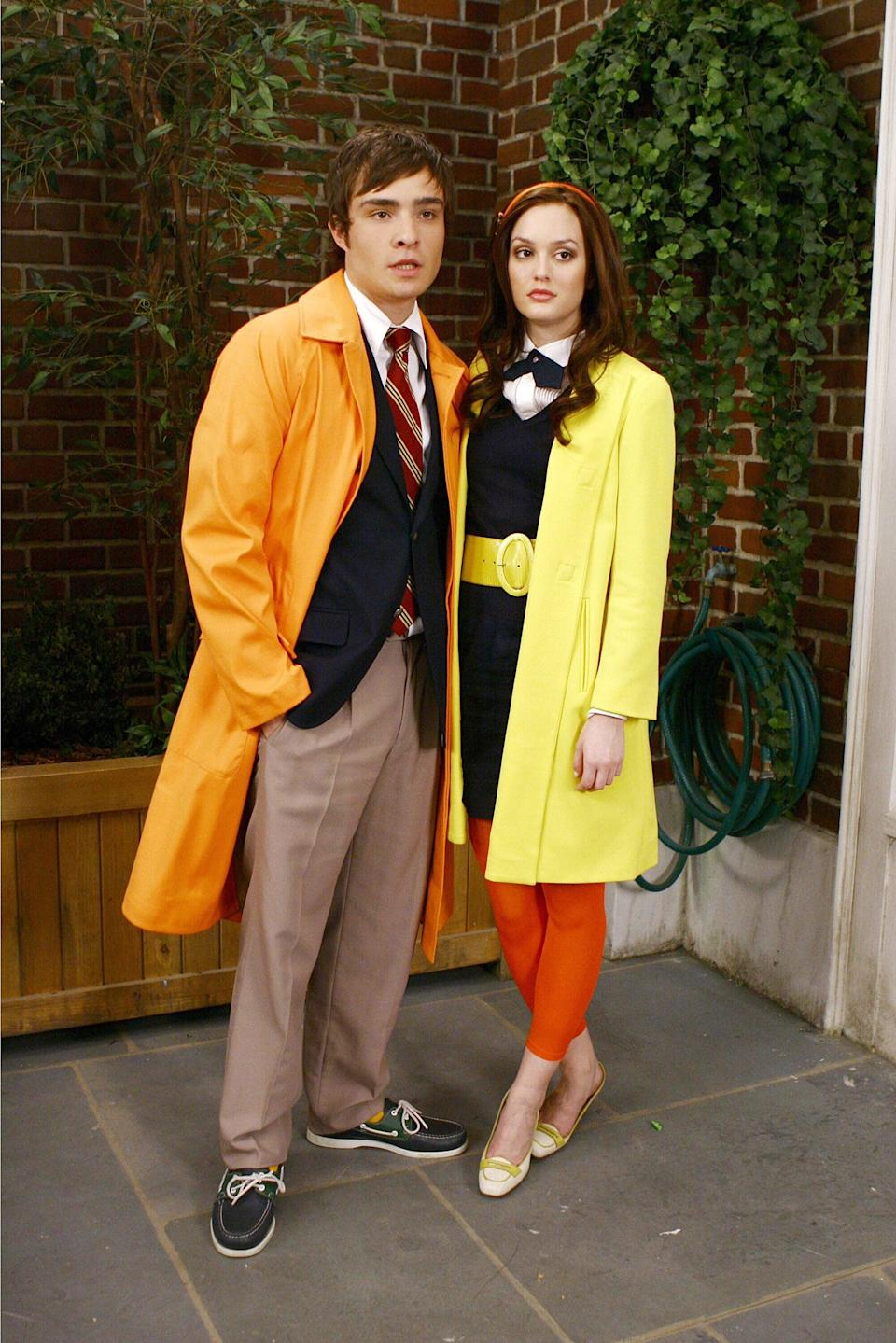 <p>Chuck wasn't afraid of wearing bright colors. Case in point? This orange trench coat that matched Blair's yellow one. </p>