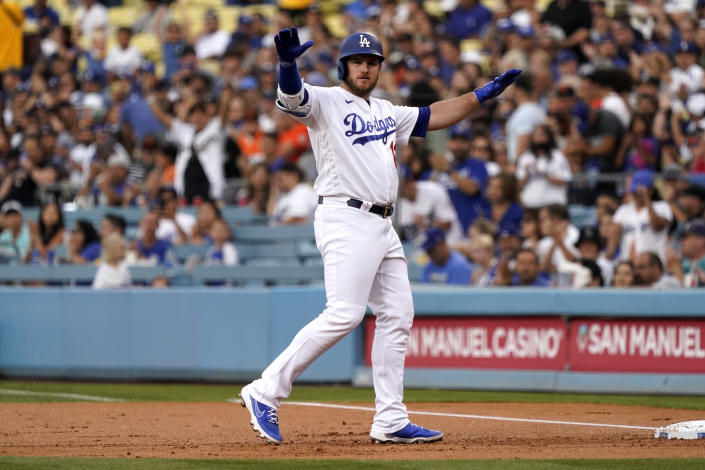 Los Angeles Dodgers' Max Muncy gestures after hitting a single during the first inning of the team's baseball game against the San Francisco Giants on Thursday, July 22, 2021, in Los Angeles. (AP Photo/Marcio Jose Sanchez)