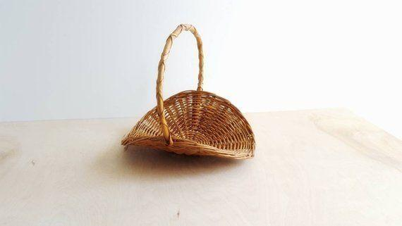 """Store magazine, fire wood, or even knitting accessories in <a href=""""https://www.etsy.com/listing/629060886/vintage-farmhouse-harvest-basket-flower?ga_order=most_relevant&amp;ga_search_type=all&amp;ga_view_type=gallery&amp;ga_search_query=woven%20baskets&amp;ref=sr_gallery-1-6"""" target=""""_blank"""" rel=""""noopener noreferrer"""">this unique vintage farmhouse basket</a> to add a touch of personality to your space."""