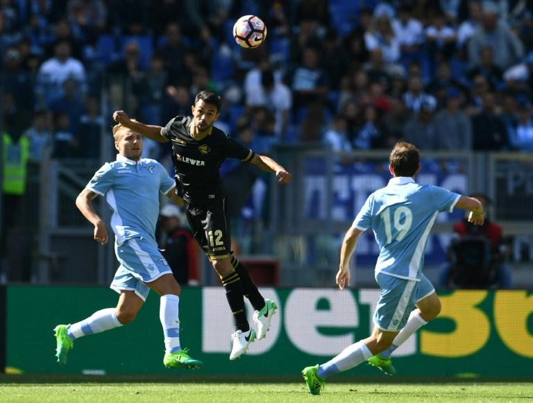 Palermo's Giancarlo Gonzalez Castro (C) heads the ball next to Lazio's Ciro Immobile (L) and Senad Lulic during their match on April 23, 2017 at the Olympic stadium in Rome