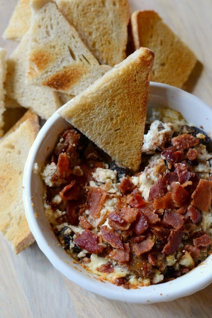 "<p>As if a creamy goat cheese dip itself isn't tempting enough, this recipe also calls for crispy bacon bits and candied pecans.</p><p><em><a href=""https://www.goodinthesimple.com/baked-goat-cheese-dip/"" rel=""nofollow noopener"" target=""_blank"" data-ylk=""slk:Get the recipe from Good in the Simple »"" class=""link rapid-noclick-resp"">Get the recipe from Good in the Simple »</a></em></p>"