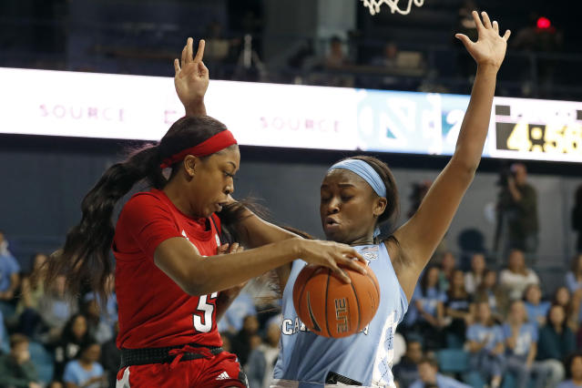 North Carolina State forward Jada Boyd (5) tries to save the ball from going out of bounds while North Carolina forward Malu Tshitenge defends during the first half of an NCAA college basketball game in Chapel Hill, N.C., Thursday, Jan. 9, 2020. (AP Photo/Gerry Broome)