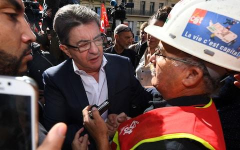 French leader of La France Insoumise far-left coalition Jean-Luc Melenchon (C) speaks with a CGT union's demonstrator during a protest called by several French unions against the labour law reform in Marseille - Credit:  ANNE-CHRISTINE POUJOULAT/AFP