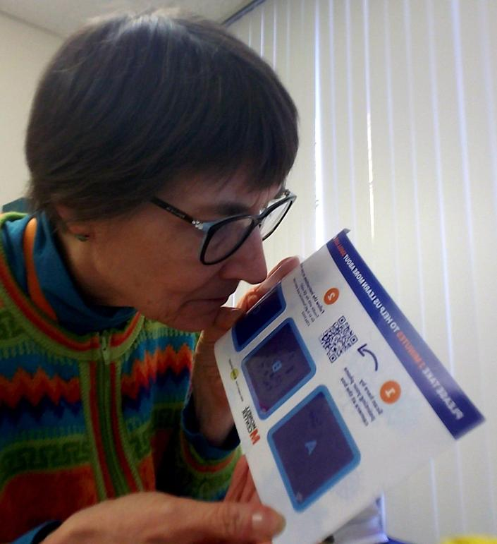 Nancy Rawson, vice president of the Monell Chemical Senses Center in Philadelphia sniffs a card designed to test whether someone has lost their sense of smell.