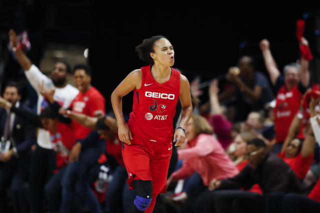 FILE - In this Thursday, Oct. 10, 2019, file photo, then-Washington Mystics guard Kristi Toliver celebrates after her 3-point basket during the first half of Game 5 of basketball's WNBA Finals against the Connecticut Sun, in Washington. The Los Angeles Sparks will be without Chiney Ogwumike and Toliver for the WNBA season so they can focus on their health the team announced Friday, June 26, 2020. (AP Photo/Alex Brandon, File)