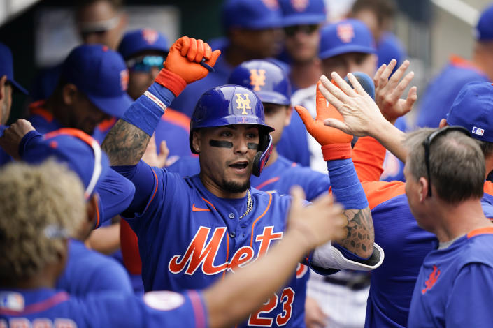 New York Mets' Javier Baez celebrates his two-run home run that also scored Michael Conforto during the fourth inning of a baseball game against the Washington Nationals, Sunday, Aug. 29, 2021, in New York. (AP Photo/Corey Sipkin)