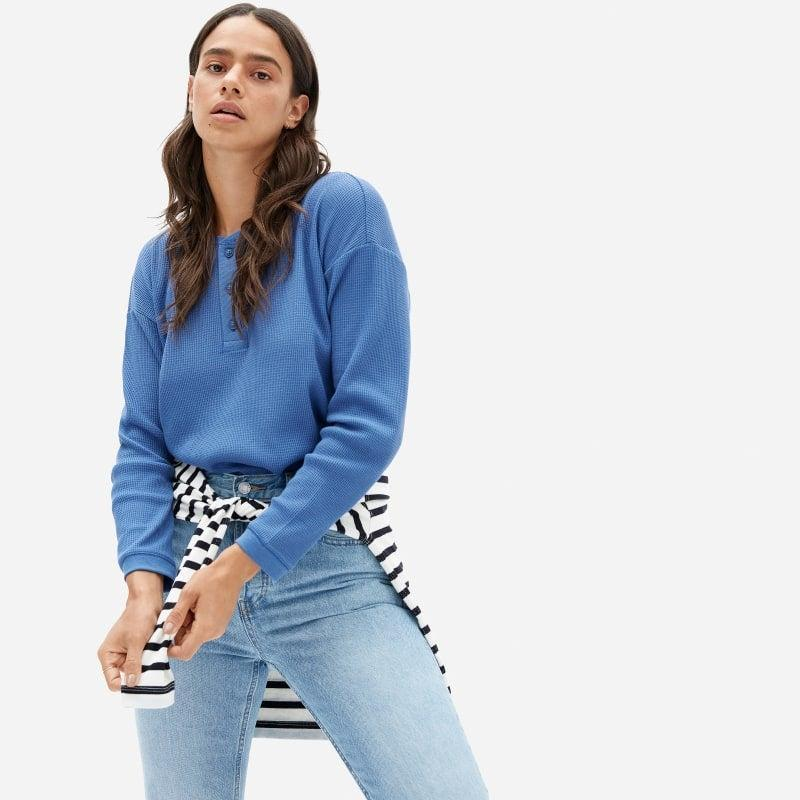 """<h3><h2>Everlane Organic Cotton Henley</h2></h3><br><strong>Available Sizes: XXS-XL</strong><br>If you aren't the turtleneck type, Everlane also offers a classic crew-neck style in the same 100% organic waffle-y fabric. We love the calming vibes this lovely blue gives off, too.<br><br><em>Shop <strong><a href=""""https://www.everlane.com/products/womens-organic-ctn-waffle-henley-morning-blue"""" rel=""""nofollow noopener"""" target=""""_blank"""" data-ylk=""""slk:Everlane"""" class=""""link rapid-noclick-resp"""">Everlane</a></strong></em><br><br><strong>Everlane</strong> The Organic Cotton Waffle Henley, $, available at <a href=""""https://go.skimresources.com/?id=30283X879131&url=https%3A%2F%2Fwww.everlane.com%2Fproducts%2Fwomens-organic-ctn-waffle-henley-morning-blue"""" rel=""""nofollow noopener"""" target=""""_blank"""" data-ylk=""""slk:Everlane"""" class=""""link rapid-noclick-resp"""">Everlane</a>"""