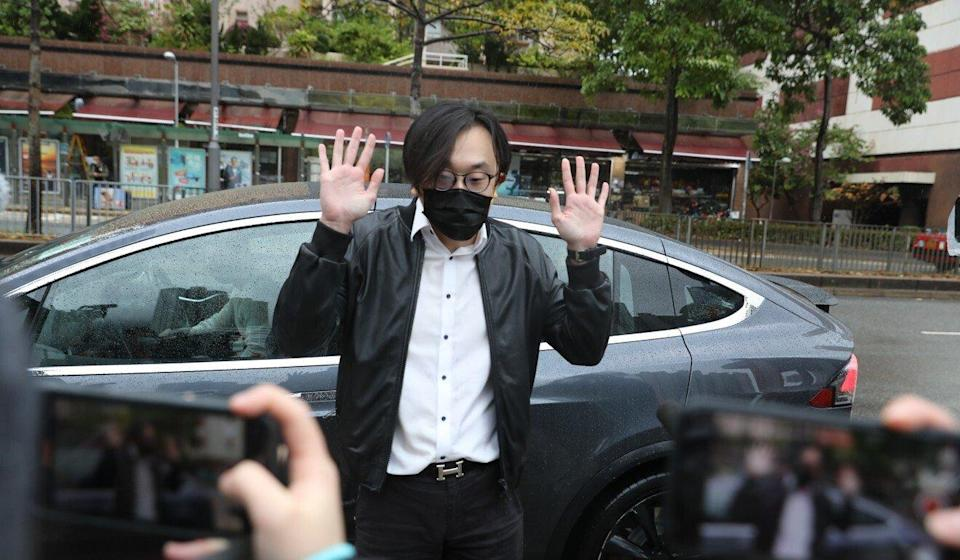 Mike Lam King-nam, founder of AbouThai, leaves Ma On Shan Police Station on Wednesday. Photo: Nora Tam