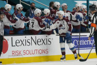 Colorado Avalanche left wing Gabriel Landeskog (92) celebrates with teammates after scoring against the San Jose Sharks during the second period of an NHL hockey game in San Jose, Calif., Monday, March 1, 2021. (AP Photo/Jeff Chiu)