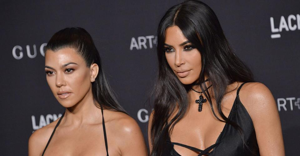 Kim Kardashian with sister Kourtney Kardashian (PA Images)