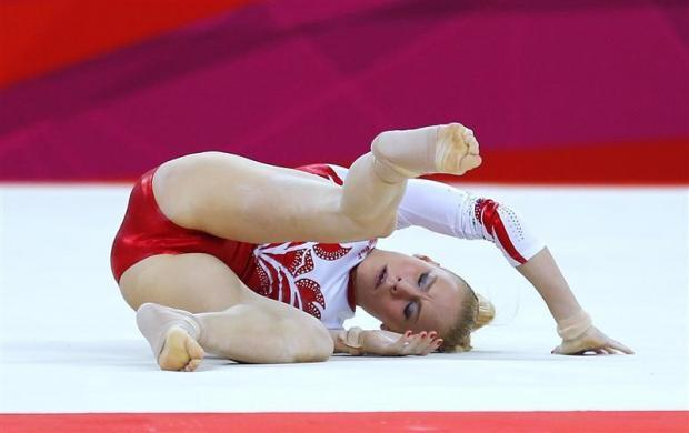 Russia's Kseniia Afanaseva falls during her floor exercise during the women's gymnastics team final in the North Greenwich Arena at the London 2012 Olympic Games July 31, 2012.